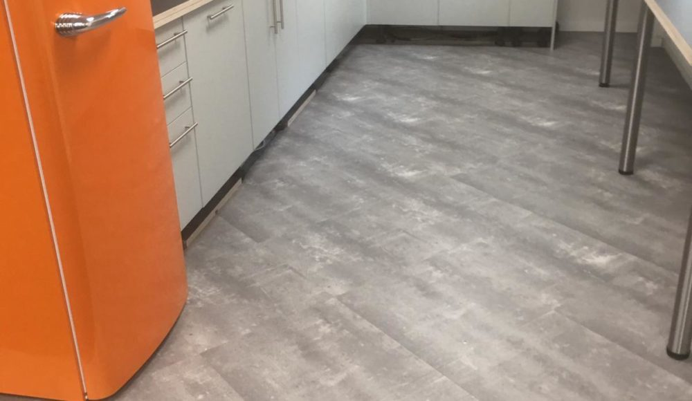 Grey Tarkett ID Inspiration vinyl in staff kitchen