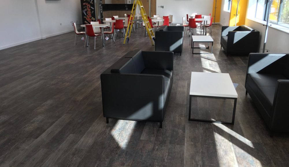 Grey Karndean vinyl planks installed in staff break out area