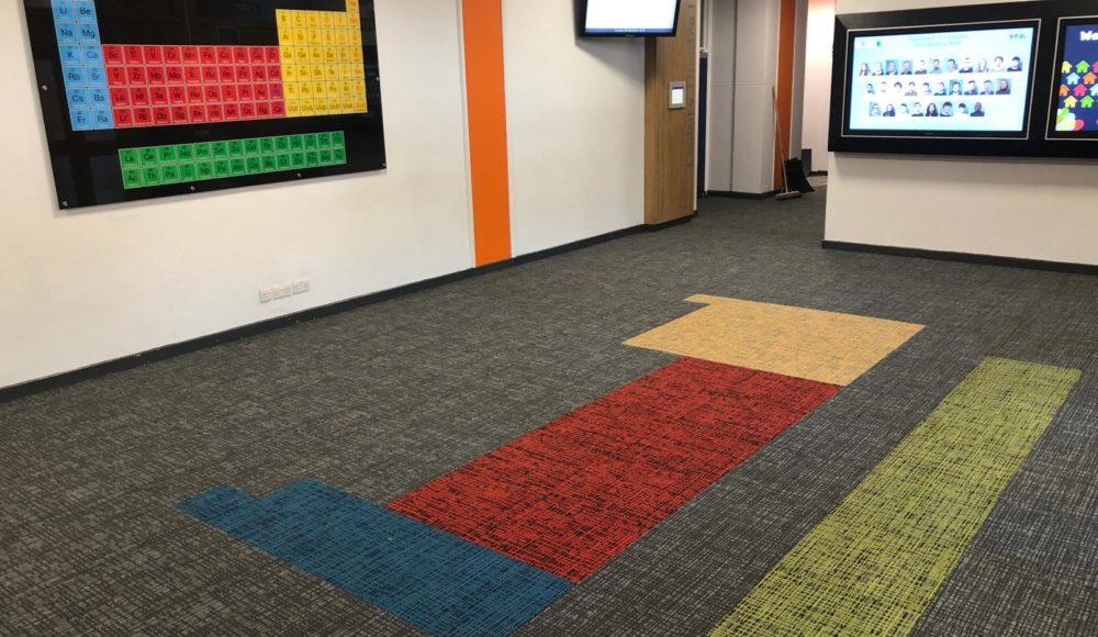 Interface carpet tiles with bespoke design